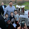 RYAN HUTTON/ Staff photo<br /> Anderson Miller, 7, Ethan Rose, 7, Jackson Miller, 10, West Newbury  pose for a picture with with former New England Patriot Joe Vellano at the Stellato Sports Draft Party at the Ferncroft Country Club.