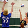 RYAN HUTTON/ Staff photo<br /> Windham's John Kane, right, leaps to knock the ball over the net during Monday's game against Salem High at Windham High.