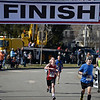 RYAN HUTTON/ Staff photo<br /> Paul Yannalfo, center, and Ryan Messiner, right, both of Andover, sprint down the final stretch of the Run for the Troops 5K at Whittier Court in Andover on Sunday.