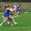 TIM JEAN/Staff photo<br /> <br /> Pinkerton's Lily Auger outruns Londonderry's defenders and scoops up the ball during a girls lacrosse game in Derry.   4/27/18