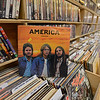 """RYAN HUTTON/ Staff photo<br /> A copy of America's """"Homecoming"""" sits in the vinyl records aisle at Comically Speaking in Reading."""