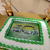 RYAN HUTTON/ Staff photo<br /> A cake commemorating the Derry Village Elementary School's 50th anniversary waits in the school's gymnasium during the reception on Thursday night.