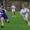 TIM JEAN/Staff photo<br /> <br /> Londonderry's Kait Bedell, left, runs to defend Pinkerton's Meaghan Michaud during a girls lacrosse game in Derry.   4/27/18