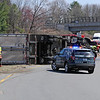 TIM JEAN/Staff photo<br />   <br /> Andover firefighters and State police investigate the scene where a tractor-trailer rolled over on the ramp from Interstate 495 North to Interstate 93 South. The truck spilled fuel as well as watermelons onto the highway.  4/28/18