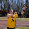RYAN HUTTON/ Staff photo<br /> Masters weight thrower Rick Brown hurls a shot put at the Whittier Tech track on Sunday.