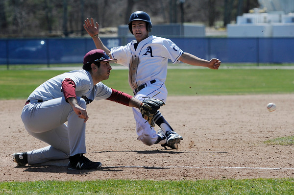 TIM JEAN/Staff photo<br />   <br /> Phillips Academy's Joe Simourian, of Andover, slides safely into third base during a baseball game against Worcester Academy. 4/21/18