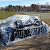 TIM JEAN/Staff photo<br />   <br /> The big rock was repainted a second time, in front of Andover High that says Respect Our Coaches.  4/24/18
