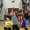 RYAN HUTTON/ Staff photo<br /> Londonderry High School Assistant Principal Katie Sullivan oversees a lopsided jump ball to kick off Monday night's game at the school gym between the faculty and the Harlem Wizards basketball team.