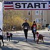RYAN HUTTON/ Staff photo<br /> The wave of walkers and runners with dogs head out after the main pack of runners during the Run for the Troops 5K on Whittier Street in Andover on Sunday.