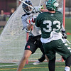 TIM JEAN/Staff photo<br />   <br /> North Andover's Ryan Slattery, left, puts pressure on Billerica's Patrick Quian as he shoots the ball during a boys lacrosse game. North Andover won 11-7.    4/26/18