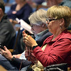 CCARL RUSSO/Staff photo. Trish Fleming knits while attending Andover's annual town meeting Monday night at the Collins Center. Town meeting warden, Dave Brown is seated next to her. 4/30/2018