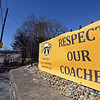 RYAN HUTTON/ Staff photo<br /> The banner Moraine Street resident Dan Gillette has hung at his home over looks the fields at Andover High. The banner asks for support for three Andover High coaches; EJ Perry, Christopher Kuchar and David Cudman.