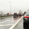 CARL RUSSO/Staff photo. Traffic on Rt. 495 north backs up on the highway, left, as well as traffic on the two lanes going under the double decker bridge because of a crash on Rt. 495 after the double decker bridge in Lawrence.  4/25/2018