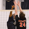 CARL RUSSO/Staff photo. Lawrence's Franco Romero battles at the net against North Andover's Colin Lee. Lawrence defeated North Andover in three straight games in volleyball action. 4/25/20188
