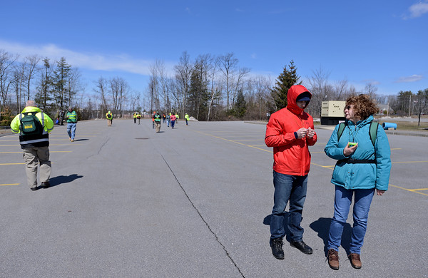 RYAN HUTTON/ Staff photo<br /> Jed Fiato, left, of Concord, and Karen Simmons, right, of Volunteer New Hampshire practice leapfrogging each other while using a compass to navigate during a recent ALERT training at the Matthew Thornton Elementary School.