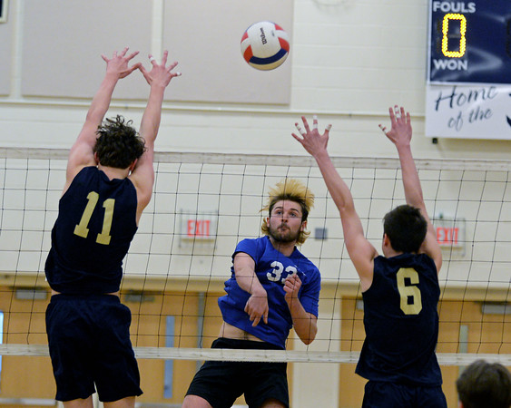 RYAN HUTTON/ Staff photo<br /> Salem's Ryan Greeley fires the ball between a pair of Windham defenders during Monday's game at Windham High.