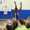 """RYAN HUTTON/ Staff photo<br /> Eric """"Broadway"""" Jones gets the crowd at the Londonderry High School gym excited at the beginning of the Harlem Wizards show on Monday night."""