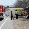 TIM JEAN/Staff photo<br />   <br /> Andover fire rescue personal and State police on the  scene at a tractor-trailer rollover on the ramp from Interstate 495 North to Interstate 93 South. The truck spilled fuel as well as watermelons onto the highway.  4/28/18
