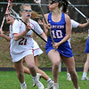 TIM JEAN/Staff photo<br /> <br /> Pinkerton's Justin Doyle, left, tries to stop Londonderry's Sarah Dvaste during a girls lacrosse game in Derry.   4/27/18