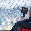 AMANDA SABGA/Staff photo<br /> <br /> A scout measures the speed of Central Catholic pitcher Steve Hajjar's pitch during a game between Central Catholic and Austin Prep at Trinity Stadium in Haverhill.<br /> <br /> 4/21/17