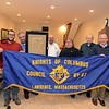 RYAN HUTTON/ Staff photo<br /> Members of the Lawrence Knights of Columbus Council 67 hold their banner aloft in their hall on Andover Street. From left are Dave Michaud, Vinny Sapienza, Joe Andrade - holding the Council's original 1893 charter - Paul Lambert, Brian Roberts, Yvon Michaud, Sean Reardon, and Dave Martineau. Council 67 will be celebrating its 125th anniversary this month.