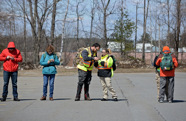 RYAN HUTTON/ Staff photo<br /> Eric Sylvestre, of Londonderry, center left, and Cara LaBelle, of Plaistow, center right, practice proper use of a compass during an ALERT training at the Matthew Thornton Elementary School.