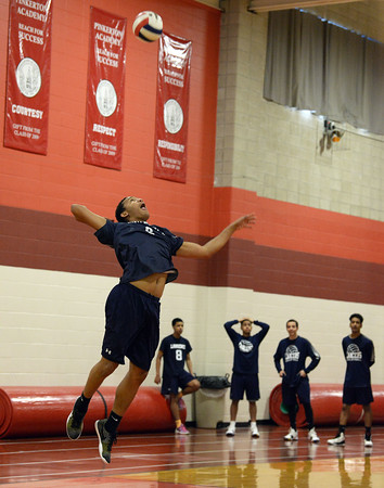 CARL RUSSO/Staff photo. Lawrence's Delfy Soler serves the ball. Lawrence high defeated Pinkerton Academy in boys volleyball action Saturday afternoon. 4/28/2018