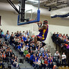 "RYAN HUTTON/ Staff photo<br /> Leon ""Space Jam"" Sewell hangs from the rim after dunking in the Londonderry High School gym during the Harlem Wizards show on Monday night."