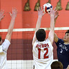 CARL RUSSO/Staff photo. Lawrence's Miguel Jackson hits the ball over the net as Pinkerton defenders reach to block.  Lawrence high defeated Pinkerton Academy in boys volleyball action Saturday afternoon. 4/28/2018