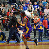 "RYAN HUTTON/ Staff photo<br /> Leon ""Space Jam"" Sewell carries Nathan Edmonds, 9, of Londonderry, around the Londonderry High gym in celebration after the youth was chosen to participate in the Harlem Wizards show on Monday night."