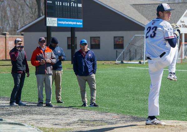 AMANDA SABGA/Staff photo<br /> <br /> MLB scouts watch as Central Catholic pitcher Steve Hajjar warms up before a game between Central Catholic and Austin Prep at Trinity Stadium in Haverhill.<br /> <br /> 4/21/17