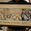 RYAN HUTTON/ Staff photo<br /> Lawrence Knights of Columbus Council 67 member Dave Michaud holds up a panorama picture from Council 67's 50th anniversary in 1943. Council 67 will be celebrating its 125th anniversary this month.