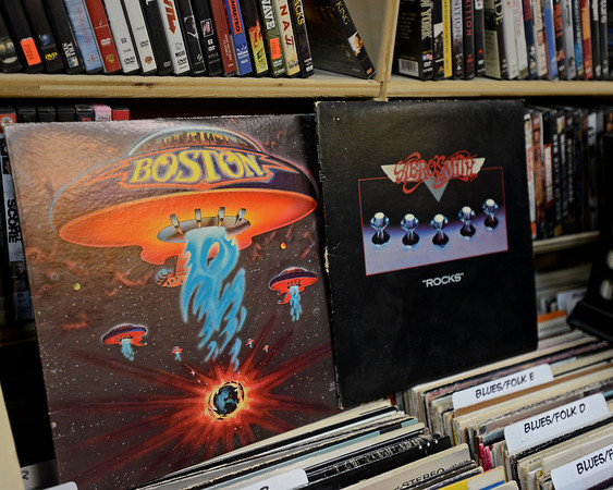 """RYAN HUTTON/ Staff photo<br /> Vinyl copies of Boston's debut album """"Boston and Aerosmith's """"Rocks"""" have recently come in from an estate sale at Comically Speaking in Reading."""