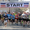 RYAN HUTTON/ Staff photo<br /> Runners take off from the starting line of the of the Run for the Troops 5K on Whittier Street in Andover on Sunday.