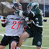TIM JEAN/Staff photo<br />   <br /> North Andover's Zach Keating, left, checks Billerica's Steve Brennan during a boys lacrosse game. North Andover won 11-7.    4/26/18
