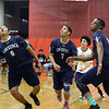 CARL RUSSO/Staff photo. From left, Lawrence's Delfy Soler, Wilbert Minier, Carlos Martinez and Franco Romero follow the ball and chase it out of bounds. Lawrence high defeated Pinkerton Academy in boys volleyball action Saturday afternoon. 4/28/2018