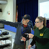 RYAN HUTTON/ Staff photo<br /> ALERT Secretary John Archambault shows Cara LaBelle, of Plaistow, how to find a point on a compass during an ALERT training at the Matthew Thornton Elementary School.