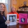 RYAN HUTTON/ Staff photo<br /> Mary Ellen D'Angelo-Lambardi, left, and Anne Marie Zanfagna, right, hold up a copy of the book of poetry and paintings they collaborated on which deals with the opioid epidemic. D'Angelo-Lambardi wrote the poetry while Zanfagna did the painting - both have lost a loved one to an overdose.