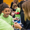 AMANDA SABGA/Staff photo<br /> <br /> Jizea Vargas, 9, talks about how many steps he took with a New Balance representative during an event at the Robert Frost School in Lawrence.<br /> <br /> 4/25/17