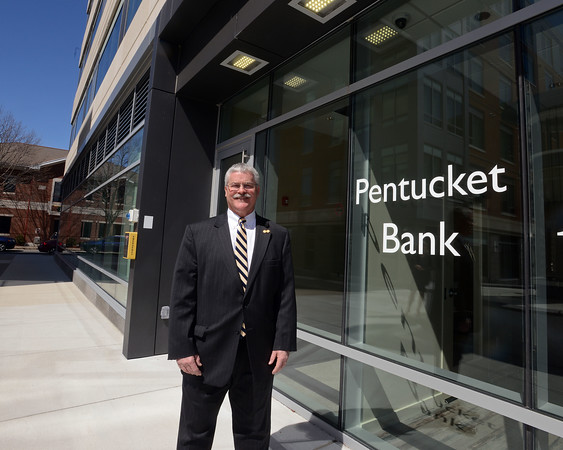 RYAN HUTTON/ Staff photo<br /> Pentucket Bank CEO Scott Cote stands near an entrance to  Harbor Place, where the bank's new offices are located.