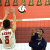 CARL RUSSO/Staff photo. Lawrence's Delfy Soler spikes the ball over the net as Pinkerton's Brian Castle goes up to block. Lawrence high defeated Pinkerton Academy in boys volleyball action Saturday afternoon. 4/28/2018