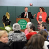 RYAN HUTTON/ Staff photo<br /> Derry Village Elementary School Principal Chris McCallum, left, and Assistant Principal Melanie Curren, right, address the crowd in the school's gymnasium during the school's 50th anniversary reception on Thursday night.