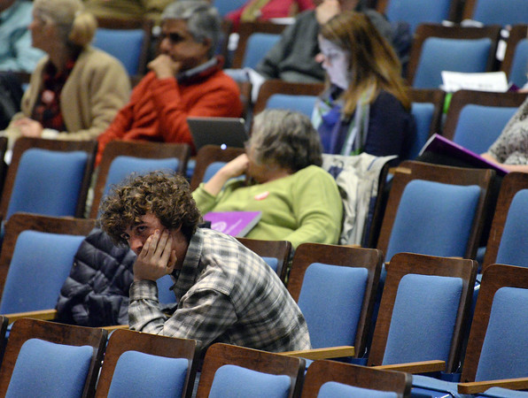 CARL RUSSO/Staff photo. Andover high senior and voter, Noah Colby was surrounded by empty seats at the annual town meeting Monday night at the Collins Center. Colby is the student liaison for the school committee and a member of the student government. 4/30/2018
