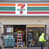 RYAN HUTTON/ Staff photo<br /> Crews work on repairing the facade of the 7-11 on Lowell Street in Lawrence after a car crashed through the front of the shop early Sunday morning.