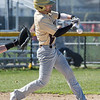 AMANDA SABGA/Staff photo<br /> <br /> Haverhill's Nick Skafas connects while at bat during a game between Haverhill High School and North Andover High School at North Andover.<br /> <br /> 4/23/17