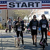 RYAN HUTTON/ Staff photo<br /> Caitlin Mooney, left, joins Salvatore and Dana DeFranco, owners of Haverhill's Battle Grounds Coffee, as they kick off the dog walker wave of the Run for the Troops 5K on Whittier Street in Andover on Sunday.