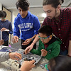 RYAN HUTTON/ Staff photo<br /> Aum Trivedi, 18, center, and Aurash Bozorgzaeeh, 18, right, help out Aaron Han, 11, bottom, and Aadi Trivedi, 13, left, during the Derive Robotics  class taught by the Andover High School seniors at the Faith Lutheran Church in Andover.