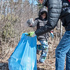 AMANDA SABGA/Staff photo<br /> <br /> Rowan Nichols, 7, of Londonderry, tosses a cup into a quickly filling bag, held by his mom Susan during Londonderry Trailways' annual clean up along the Londonderry Rail Trail.<br /> <br /> 4/21/17