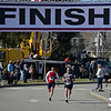 RYAN HUTTON/ Staff photo<br /> Alex Smirnou, left, and Mike Roos, right, both of Andover, speed down the final stretch of the Run for the Troops 5K at Whittier Court in Andover on Sunday.