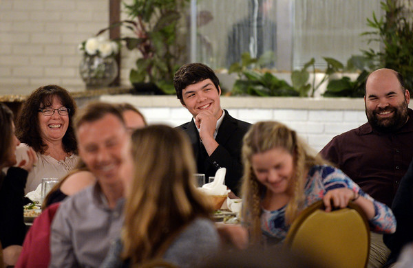 RYAN HUTTON/ Staff photo<br /> Whittier Tech's Andrew Buzzell smiles with his family as he watches a video featuring himself at the Eagle-Tribune's Student Athlete of the Year awards banquet at Michael's Function Hall on Wednesday night.